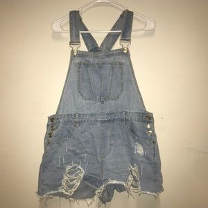 Distressed blue jean overalls
